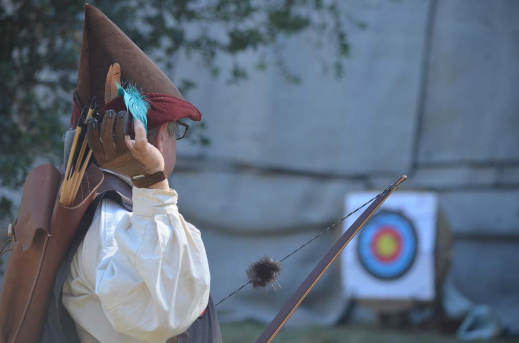 An archer prepares a shot for the archery contest. Photo by Tony Cagala