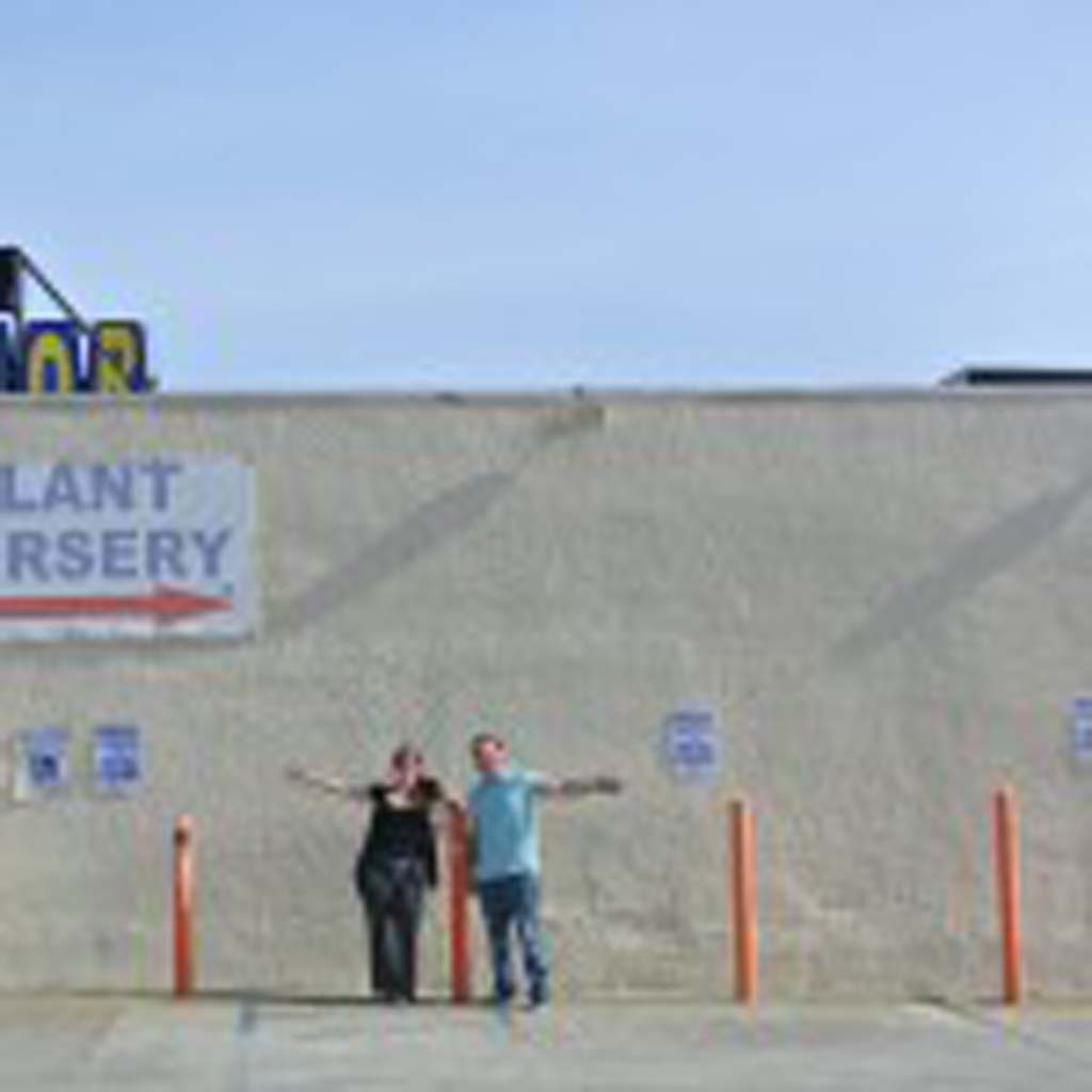 From left, Jax Meyers, founder of Paint Encinitas, and Royal Liquor Store's Co-owner Moe Georges stand outside the store in front of the wall which will be painted as a part of Paint Encinitas' first mural project. Photo by Yeshe Salz