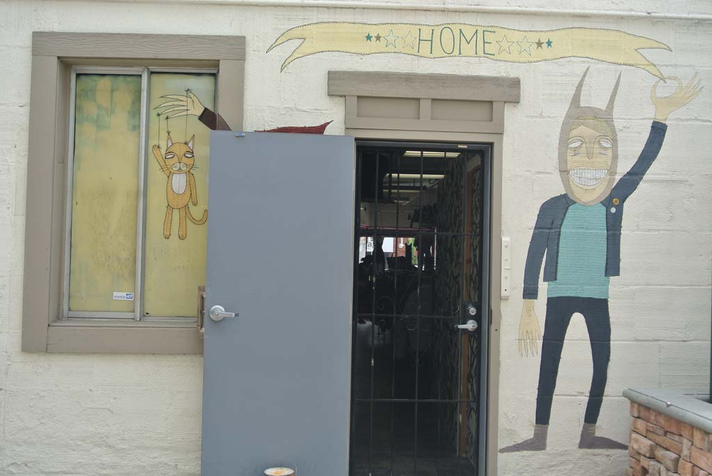 Unfinished mural by P. Daniel Aguilar at the back entrance of HOME clothing store in Encinitas. Photo by Yeshe Salz