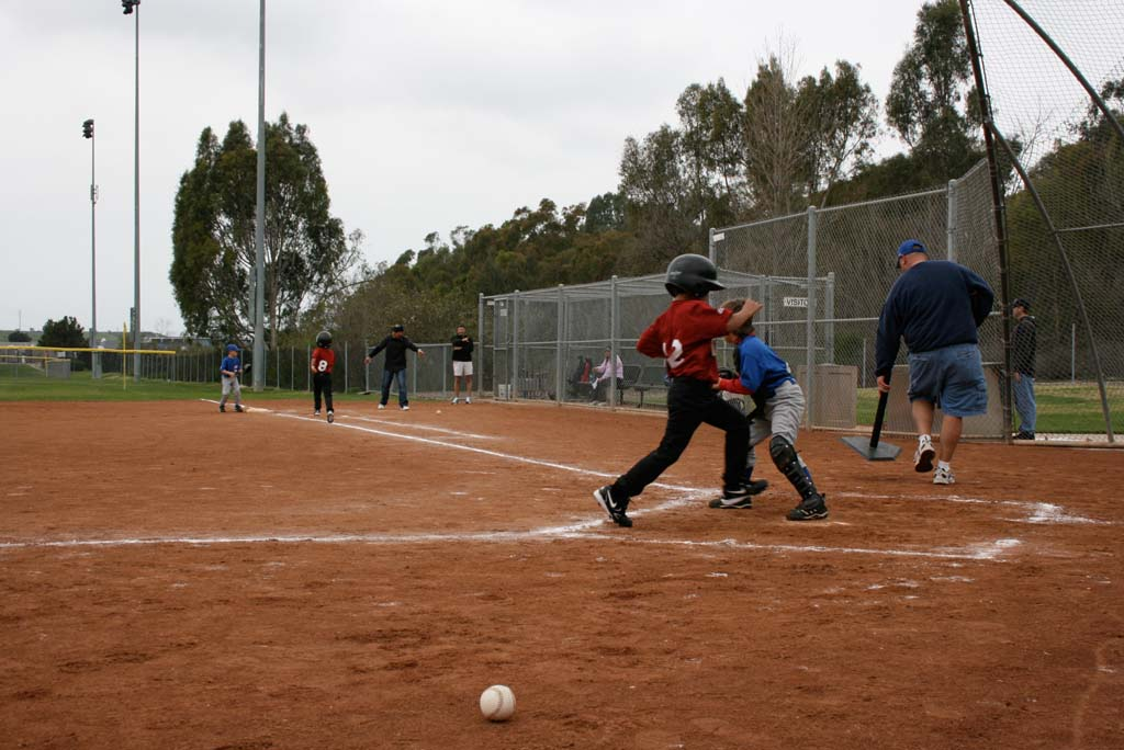 Little League rules require well-lit fields for evening games and practices. Oceanside's hourly rate for field lights is higher than neighboring cities. Photo by Promise Yee