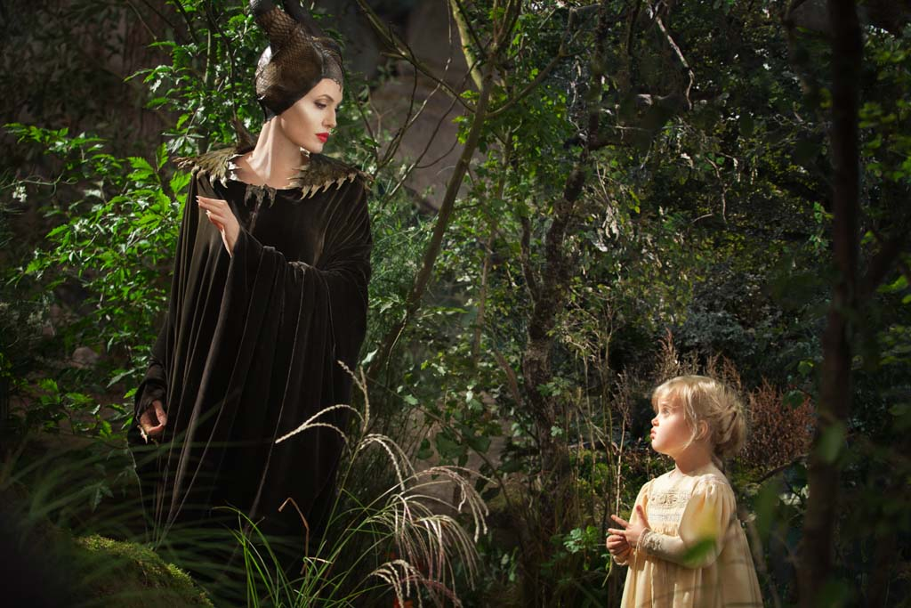 Maleficent (Angelina Jolie) and Young Aurora (Vivienne Jolie-Pitt) in Disney's Maleficent now playing. Photo by Frank Connor