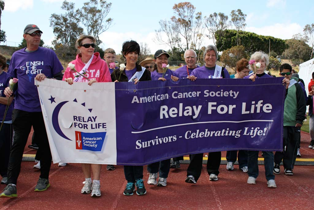 Cancer survivors take the first walk around the track in the 24 Hour Relay For Life. Survivors have defeated cancer for 4 months to 33 years. Photo by Promise Yee