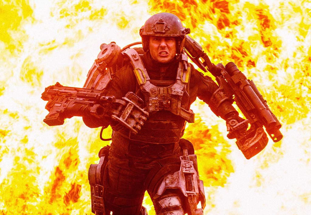 """Major William Cage (Tom Cruise) relives the same day over and over again while battling aliens in """"Edge of Tomorrow."""" Photo by David James"""