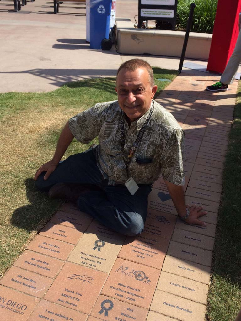 Shoja Naimi of Roxy's inspects the Naimi brick at the Don Diego Scholarship Foundation legacy brick path at the Legacy Brick Fountain at the San Diego County Fairgrounds. The purchase of bricks supports foundation scholarships.