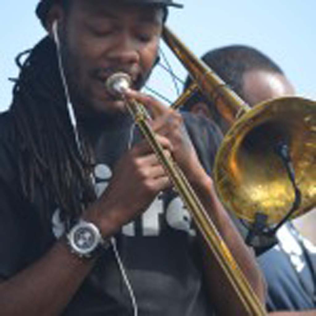 Corey Peyton of The Soul Rebels sets the level of his trombone before the band began performing at the Fiesta del Sol Saturday afternoon. Photo by Tony Cagala