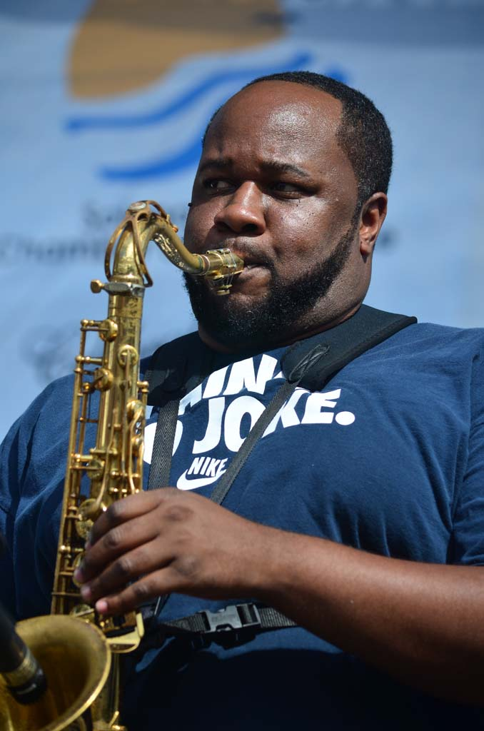 "The Soul Rebels' saxophonist Erion Williams leads the band in a cover of the Eurythmics' ""Sweet Dreams (Are Made of This),"" on Saturday. Photo by Tony Cagala"