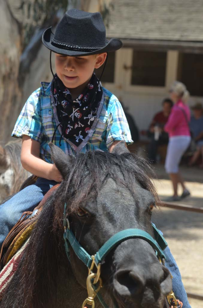 Quinlan Price takes a pony ride during the Wild West Days at Leo Carillo Rancho in Carlsbad. Photo by Tony Cagala