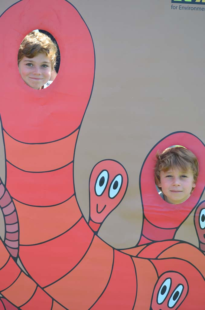 Benny Pollack, 6, and Justin Pollack, 7, see what it's like to be an earthworm. Photo by Tony Cagala