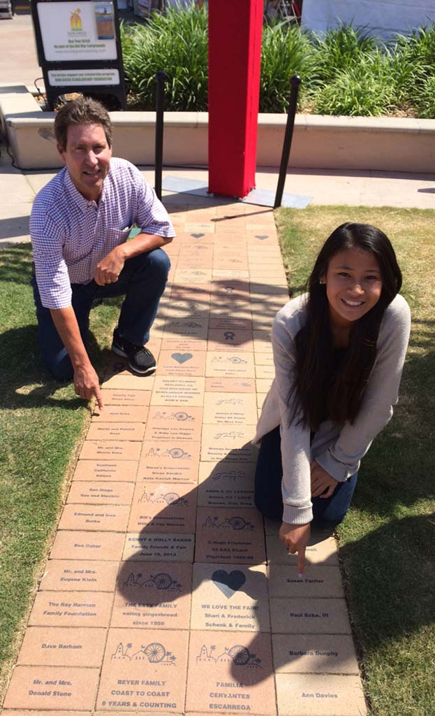 Paul Ecke, and his daughter Polly, inspect their memorial bricks at the Don Diego Scholarship Foundation legacy brick path at the Legacy Brick Fountain at the San Diego County Fairgrounds. The purchase of bricks supports foundation scholarships. Courtesy photos