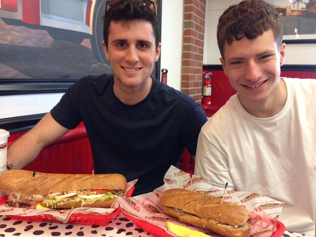 Quinn Boylan and his mate Niall McCarter enjoying their Firehouse Subs on a recent visit from England. Photo by David Boylan