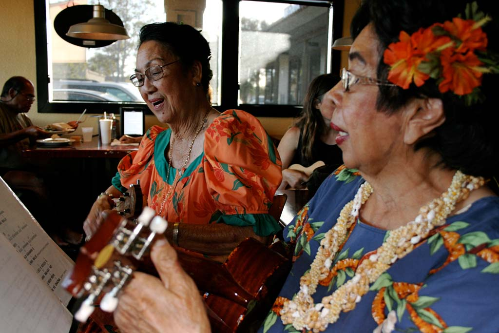 Musicians Luana Rebar and Vergie Thames play regularly with the group. The Moonlight Beach Strummers perform at festivals about six times a year. Photo by Promise Yee