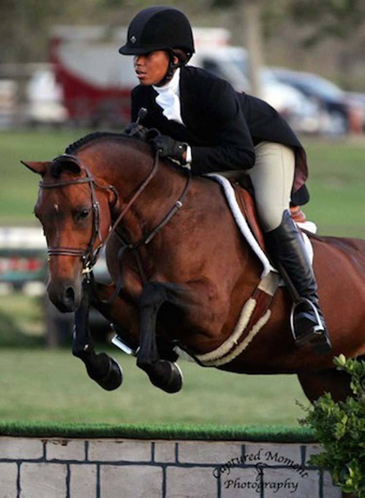 Bianca Jenkins on her medium pony, Fine Art, won the Pony Hunter Derby at the Blenheim Red, White & Blue Classic.