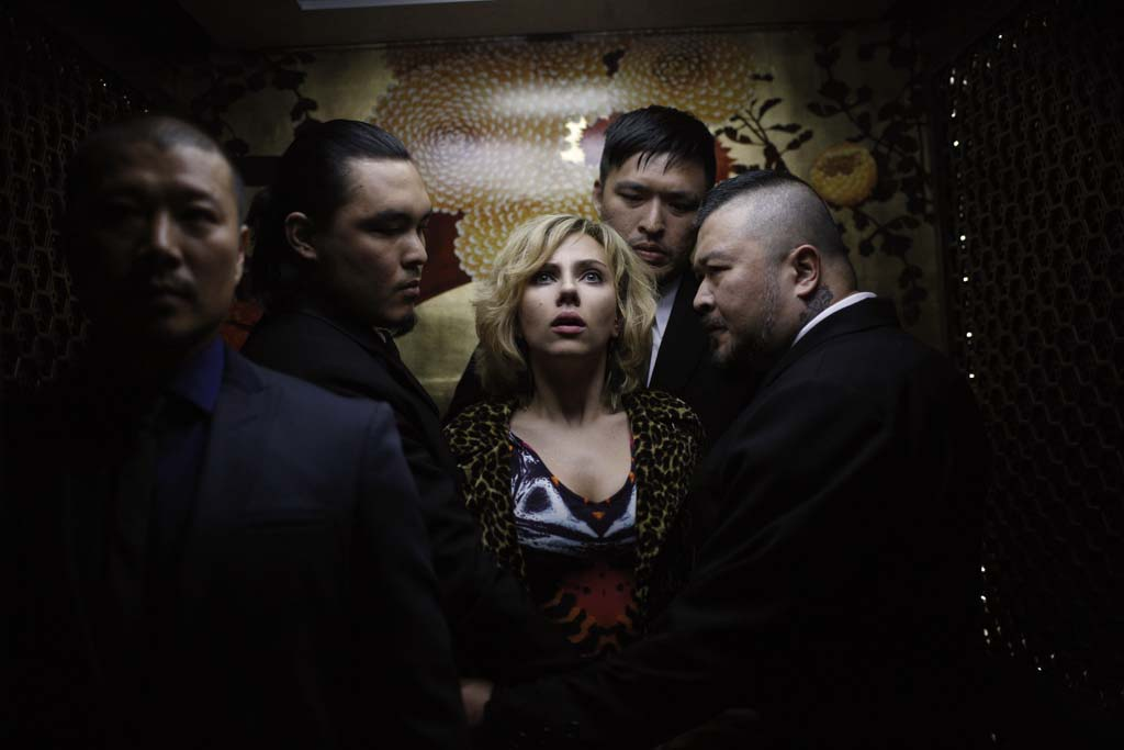 "Lucy (Scarlett Johansson) is temporarily held hostage by thugs in ""Lucy."" Photo by Jessica Forde"