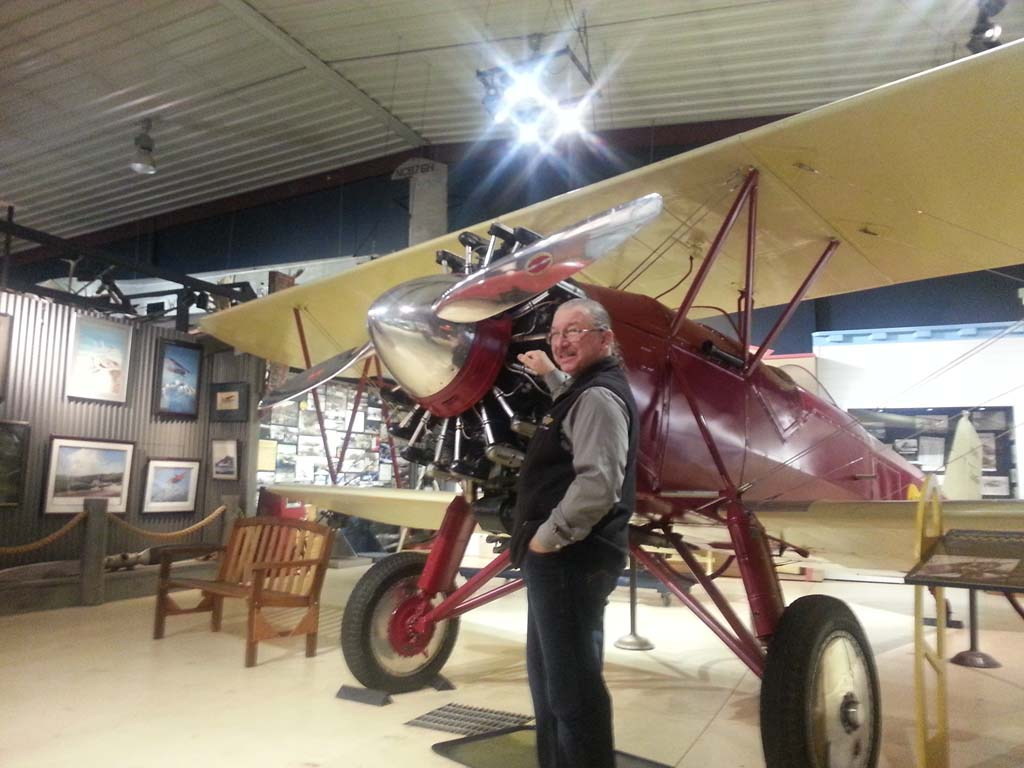 """Mark Ransom, an employee, pilot and docent at the Alaska Aviation Museum, stands by a 1928 Stearman (NC5415), flown by many of Alaska's early aviation heroes, including Wiley Post (who died with Will Rogers) and Merle """"Mudhole"""" Smith. In 1932, this plane conducted the first landing and rescue on 20,000-foot Mt. McKinley.It crashed in 1937, was recovered in the mid-1960s, restored to flying condition and purchased by the museum in 1991. The museum is dedicated solely to the history of aviation in Alaska. [Courtesy photo]"""