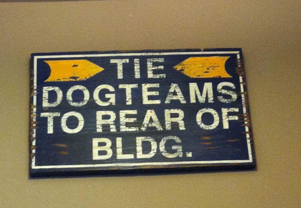 This sign hangs in the bar of the downtown Historic Anchorage Hotel, a reminder of the hotel's heritage. Half of the original hotel survived the 1964, 9.2 earthquake, which caused part of downtown Anchorage to sink 14 feet. Today the 26-room boutique hotel is listed on the National Register of Historic Places.  [Photo by E'Louise Ondash]