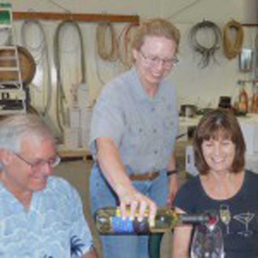 Wine lovers Walt and Jean Stringer being poured a 2013 Whitewater Hill Vineyards Dry Riesling by owner Nancy Janes. Photos by Frank Mangio