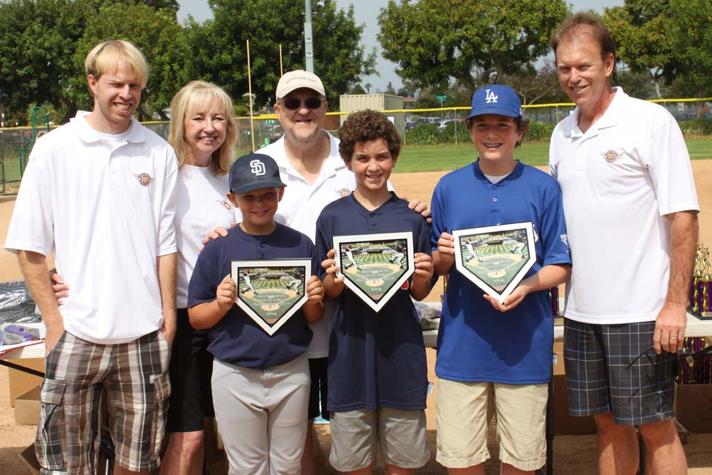 From left, this year's Carlsbad Youth Baseball winners of the Mitchell Thorpe award are, from left, Collin Johnson, Tommy Donahue, and Cameron Phillips, joined by coaches and parents. Courtesy photos