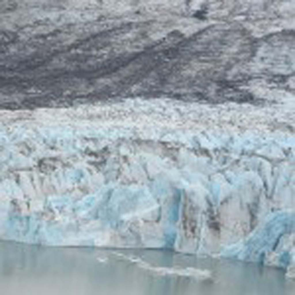 The Knik Glacier near Anchorage shows shades of blue because the dense glacier ice absorbs all colors of the spectrum except blue – the only color we see. Glaciers in this area once were 4,000 feet deep and are responsible for carving the valley where Anchorage sits today.
