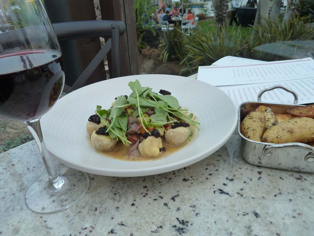 Tidal Executive Chef Amy DiBiase develops an Italian-style custom dish, Ricotta Gnudi, only found at Tidal.  Try it with a good Pinot Noir. Photo by Frank Mangio