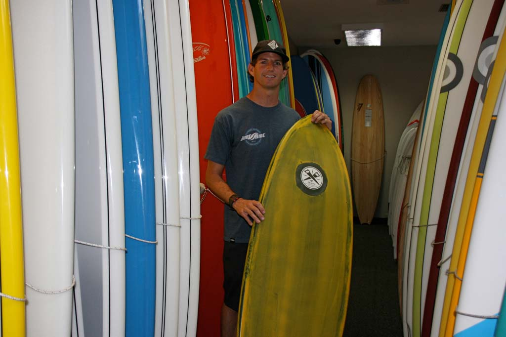 Josh Bernard, Surf Ride CEO, shows off a Surf Ride board. Surf Day was declared in Oceanside in recognition of the surfing industry. Photo by Promise Yee