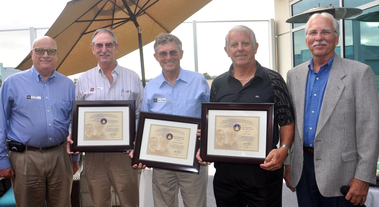 "From left, Jerry Pendzick from the FAA congratulates Wright Brothers Master Pilot Award recipients Rock Swanson, John Graybill and Stu Evans, joined by Steve Nelson, also from the FAA.  Nelson commented after handing out the awards ""It's exciting to see all the work my fellow pilots have endured over a lifetime. Always amazing."" Courtesy photo"