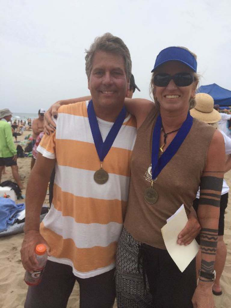 Members of the Del Mar BodySurfing Club, Dave Lane and Briguitte Wiedemeyer, earned Gold Medals at the Aug. 4 International Bodysurfing Championships. Courtesy photos
