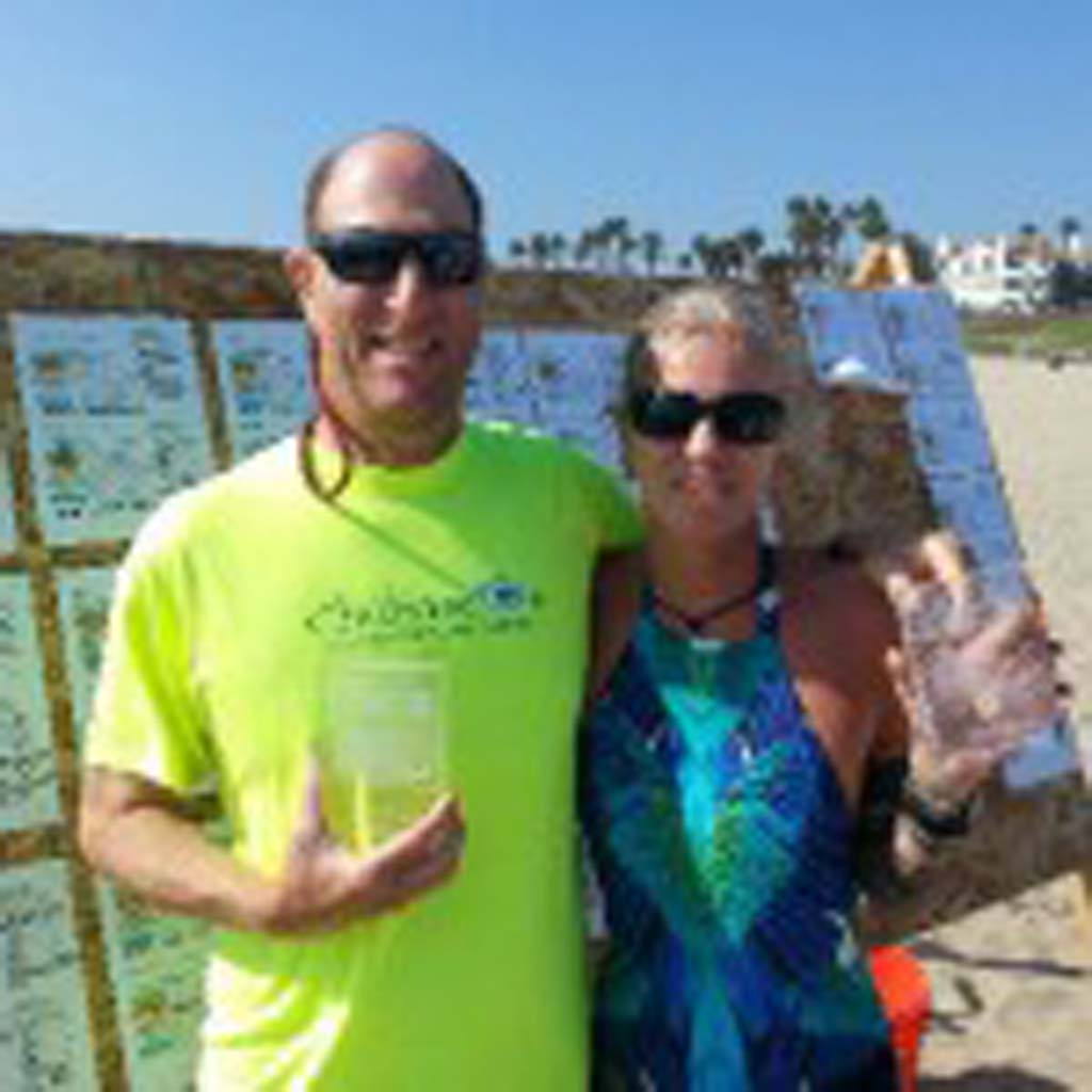 From left, Bruce Robbins and Briguitte Linn Wiedemeyer, show their awards from the 2014 Huntington Beach Bodysurf Championship. Courtesy photos