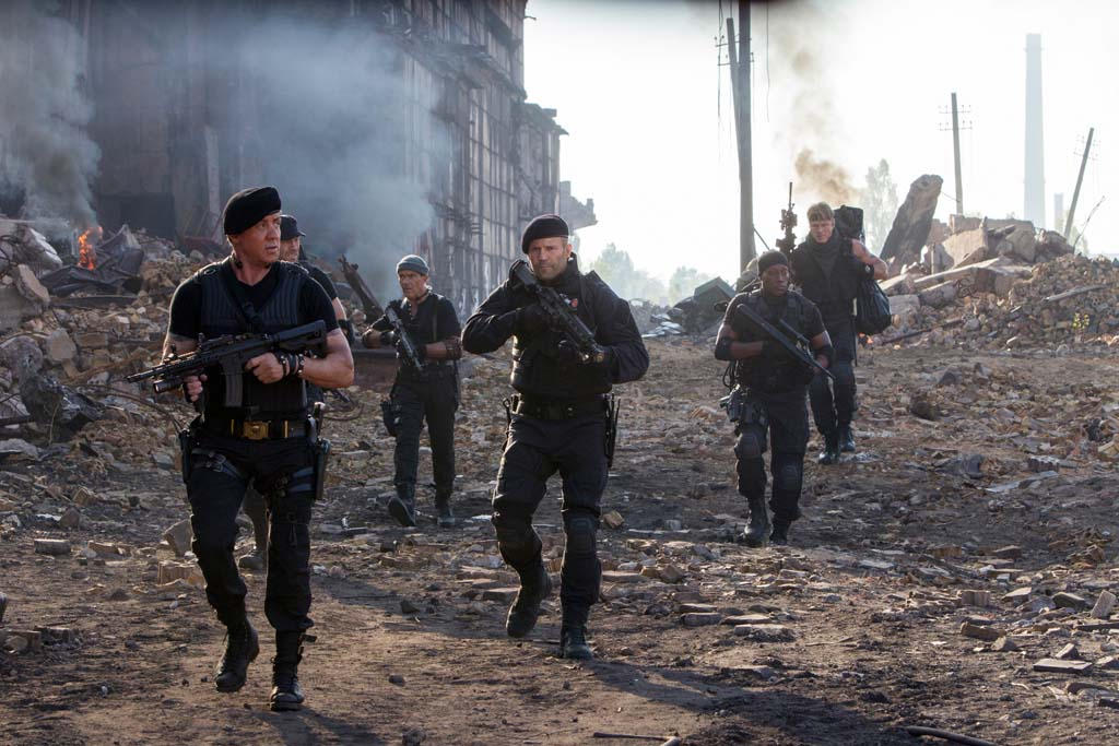 "From left: Barney Ross (Sylvester Stallone), Toll Road (Randy Couture), Galgo (Antonio Banderas), Lee Christmas (Jason Statham), Doc (Wesley Snipes), and Gunner Jensen (Dolph Lundgren) in ""The Expendables 3."" Photo by Phil Bray"