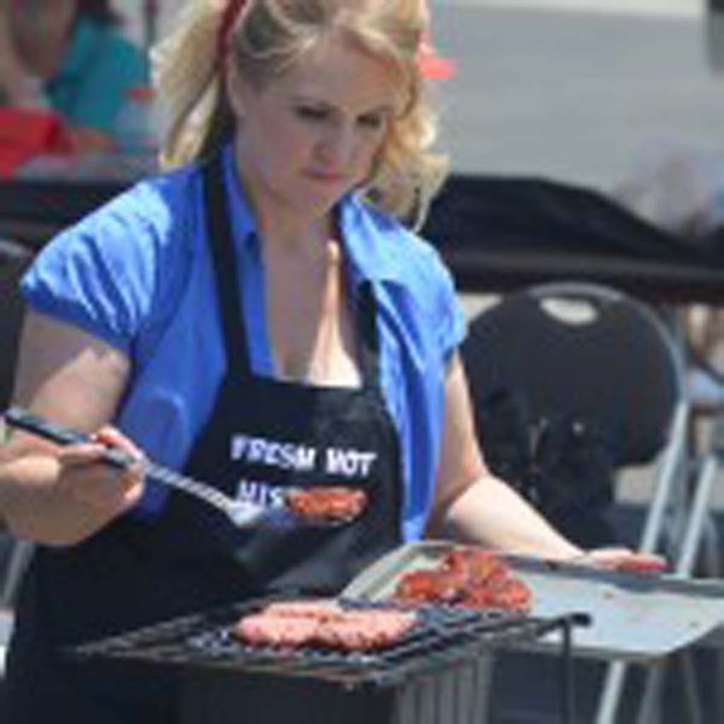 Kelly Shippey of Orange, Calif. competes in the Burger Battle in San Marcos on Aug. 9. Shippey would win the competition and will be going to Las Vegas to compete in the World Burger Championships later this year. Photo by Tony Cagala