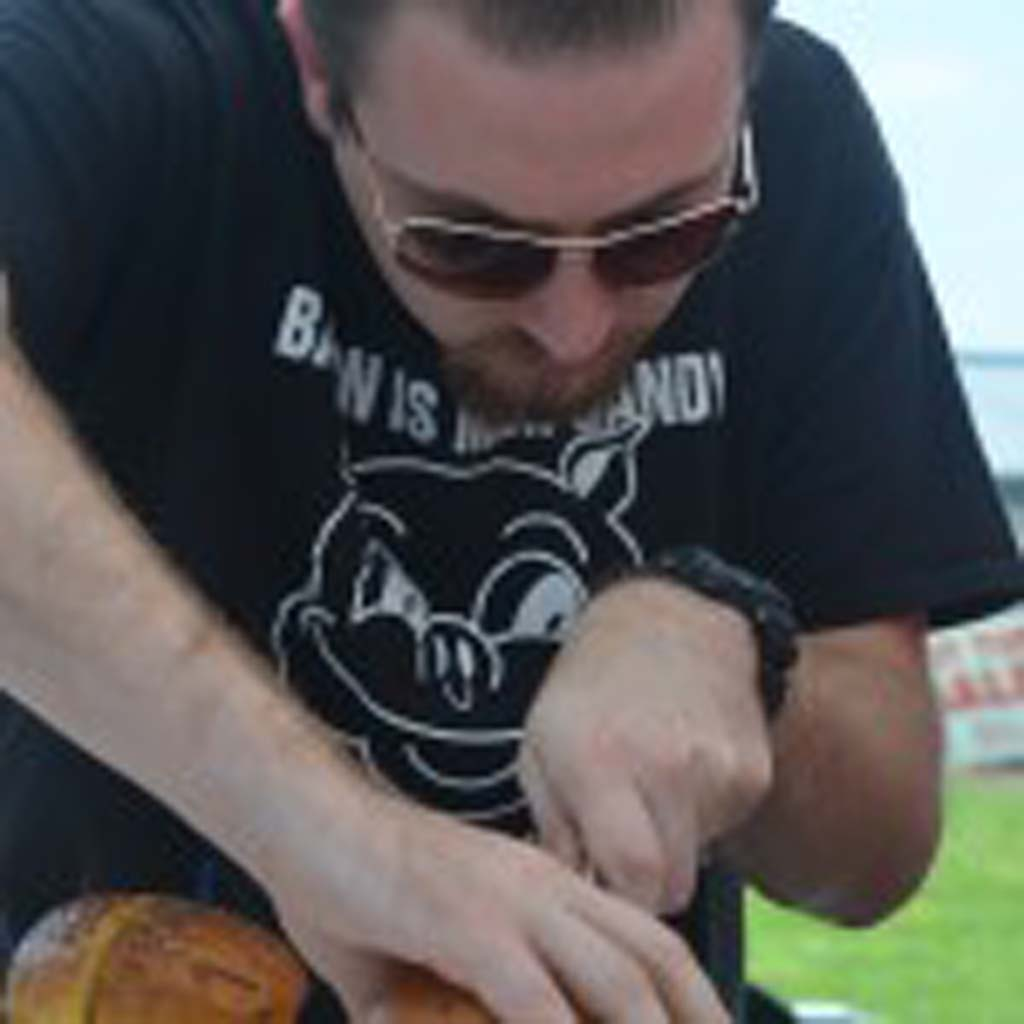 Matt Otto of Daddy O's BBQ in Temecula prepares a bacon burger. Photo by Tony Cagala