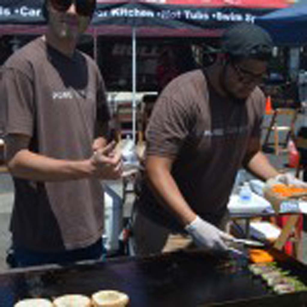 David Powell, left, and Sebastian Alvarez of Pure Burger in Carlsbad compete for the first time in the Burger Battle in San Marcos. Photo by Tony Cagala