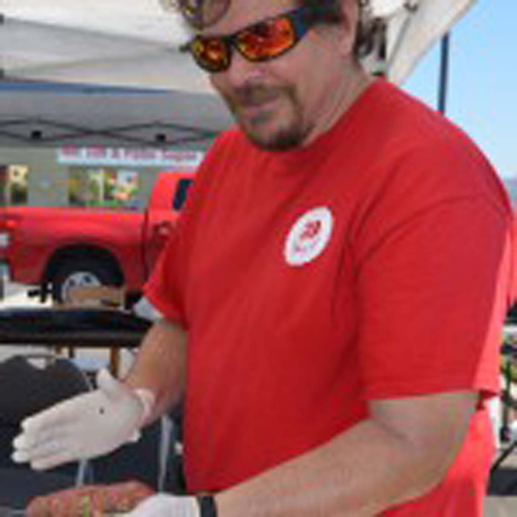 Vista resident Rick McDonald prepares a sweet Thai chili burger for the Burger Battle on Saturday. Photo by Tony Cagala