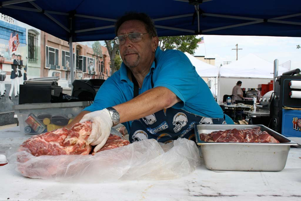 "Ira Pupko of Hog Heaven Sauces prepares for competition. A ""meat and greet"" was held the evening before the Vista BBQ Classic. Photo by Promise Yee"