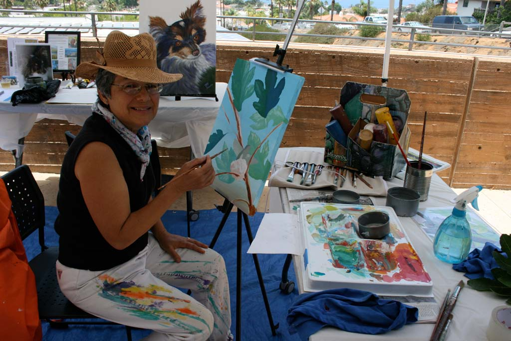 Mural artist Linda Luisi demonstrates live painting during the fundraiser. Paintings were auctioned off to raise funds for the Rancho Coastal Humane Society. Photo by Promise Yee