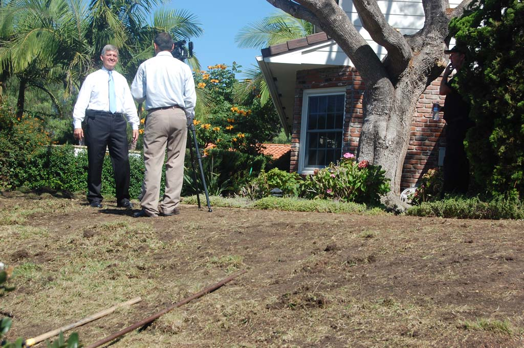 County Supervisor Dave Roberts answers a reporter's questions about the removal of his front and back lawns, which are being replaced with artificial turf for an expected annual savings of 264,000 gallons of water. Photo by Bianca Kaplanek