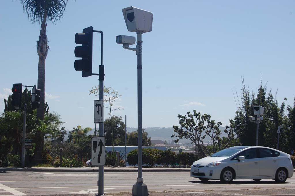 Disappointed by safety data presented at a recent meeting, council members may consider eliminating red-light cameras such as these at Via de la Valle and Camino del Mar, but not before June 2016, when the current contract expires. Photo by Bianca Kaplanek