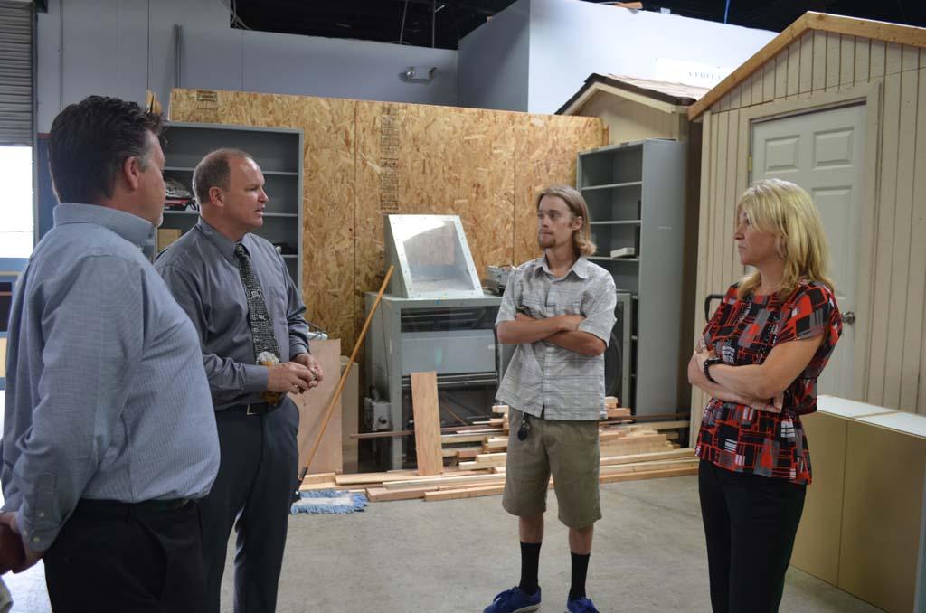 From left: Derek Wachter of H.G. Fenton, North County Trade Tech Principal Phil Lutgen, North County Trade Tech senior Travis Hamlin and H.G. Fenton Executive Vice President Kari Prevost tour one of the project areas on the Vista campus. Photo by Tony Cagala