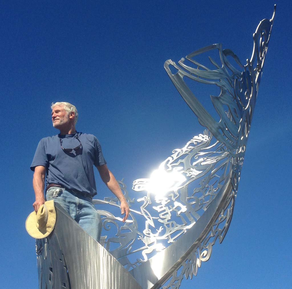Artist Roger White Stoller admires the final installation of his Costal helix. Photo by Ellen Wright