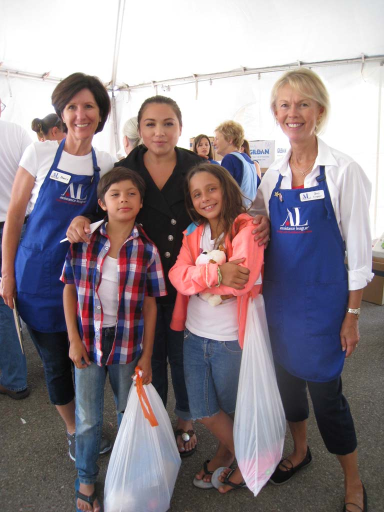 From left, Assistance League of Rancho San Dieguito member Joy Lappe,helps Noah and Paris Acala, and their mom, select some new school clothes and supplies, along with Assistance League member Darcy Friedman. Courtesy photo