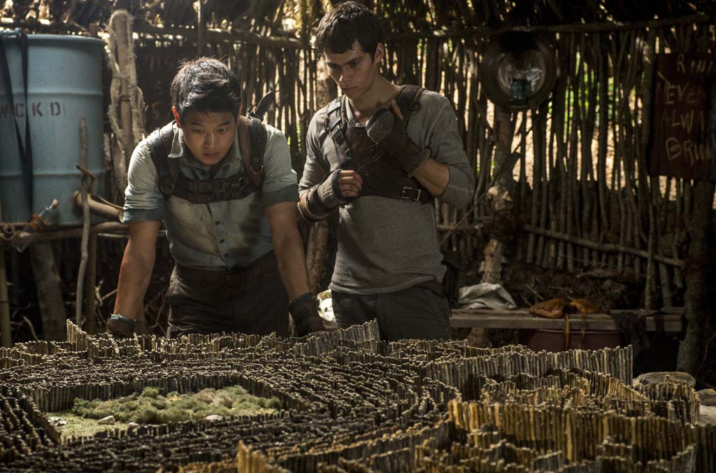 """Minho (Ki Hong Lee, left) and Thomas (Dylan O'Brien, right) devise an escape plan in """"The Maze Runner."""" Photo by Ben Rothstein"""