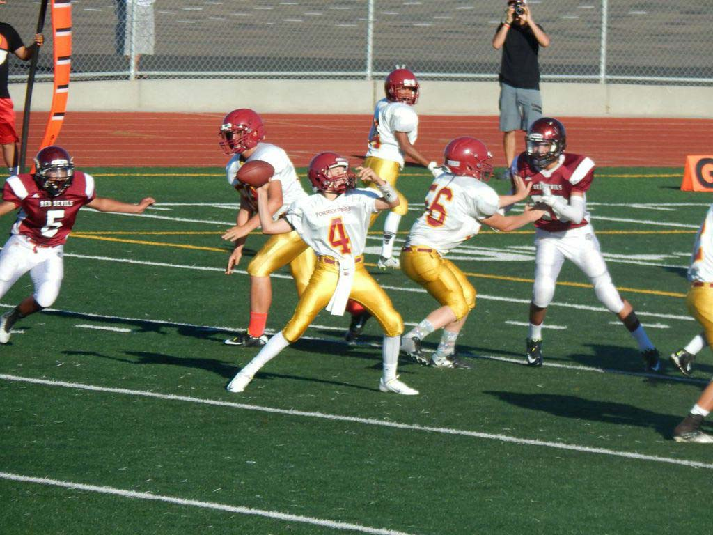 Torrey Pines freshman Offensive Lineman Ryan Vincent (56) protects Jackie Plashkes as he throws a touchdown during their first game of the season, a 41-0 route of Sweetwater High School. Courtesy photo