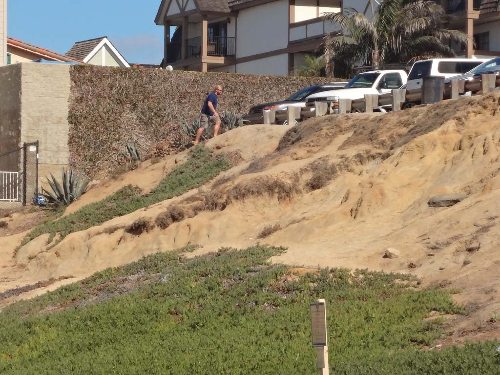 Bluff erosion is sped up when people use the face of the bluff to access the beach. City officials approved funding towards the addition of a low fence near the Ocean Street parking lot in order to minimize pedestrian access on the bluff. Photo by Ellen Wright