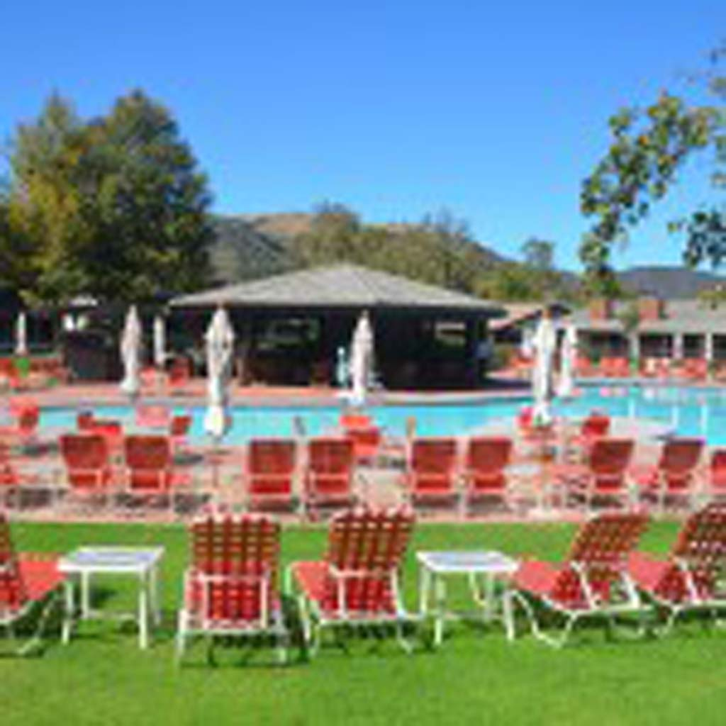It's hard to believe that Alisal Guest Ranch and Resort was once just a collection of cattlemen's quarters. Today, the resort has many amenities, including this pool. Guests also can enjoy the golf course; library; facilities for children's activities; petting zoo; and private lake where guests can fish and kayak. (Photo by Jerry Ondash)