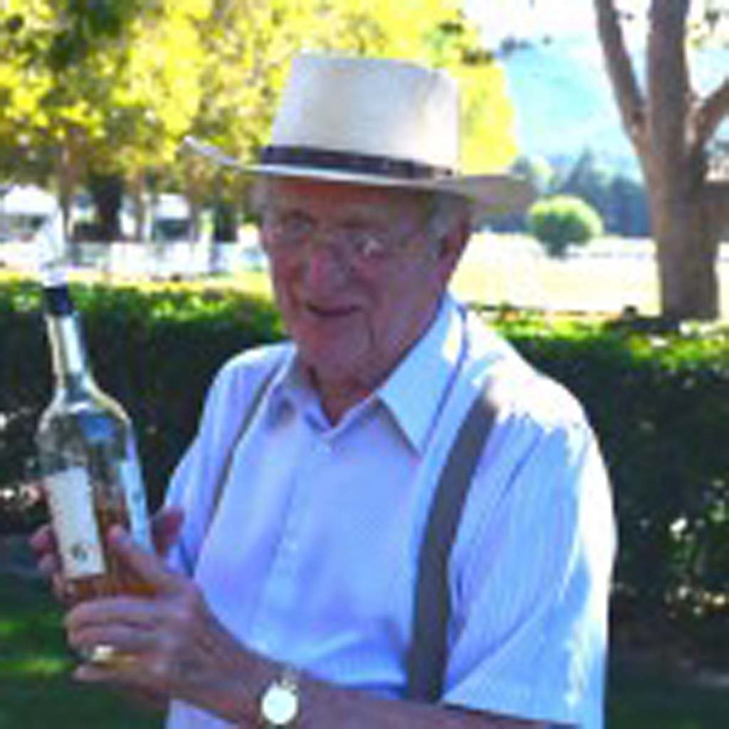 "BellaCavalli-Dr. Jack Lockwood – Dr. Jack Lockwood offers visitors at Bella Cavalli Farms & Vineyard a sample of its unique white cabernet. The vineyard makes only 1,600 cases a year, and tastings are by appointment only. Bella Cavalli in Italian translates as ""beautiful horses."" The vineyard's owners also raise and board show horses. ALL PHOTOS BY Jerry Ondash"