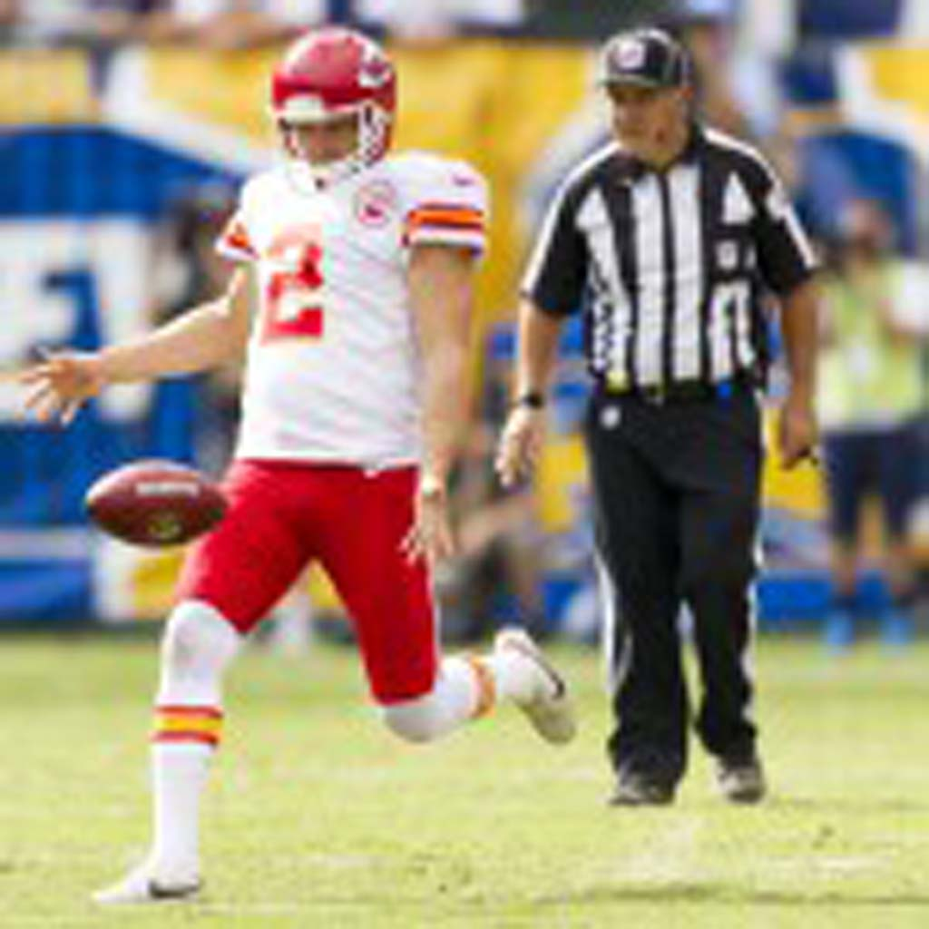 Kansas City Chiefs punter Dustin Colquitt punts during the second quarter. Photo by Bill Reilly