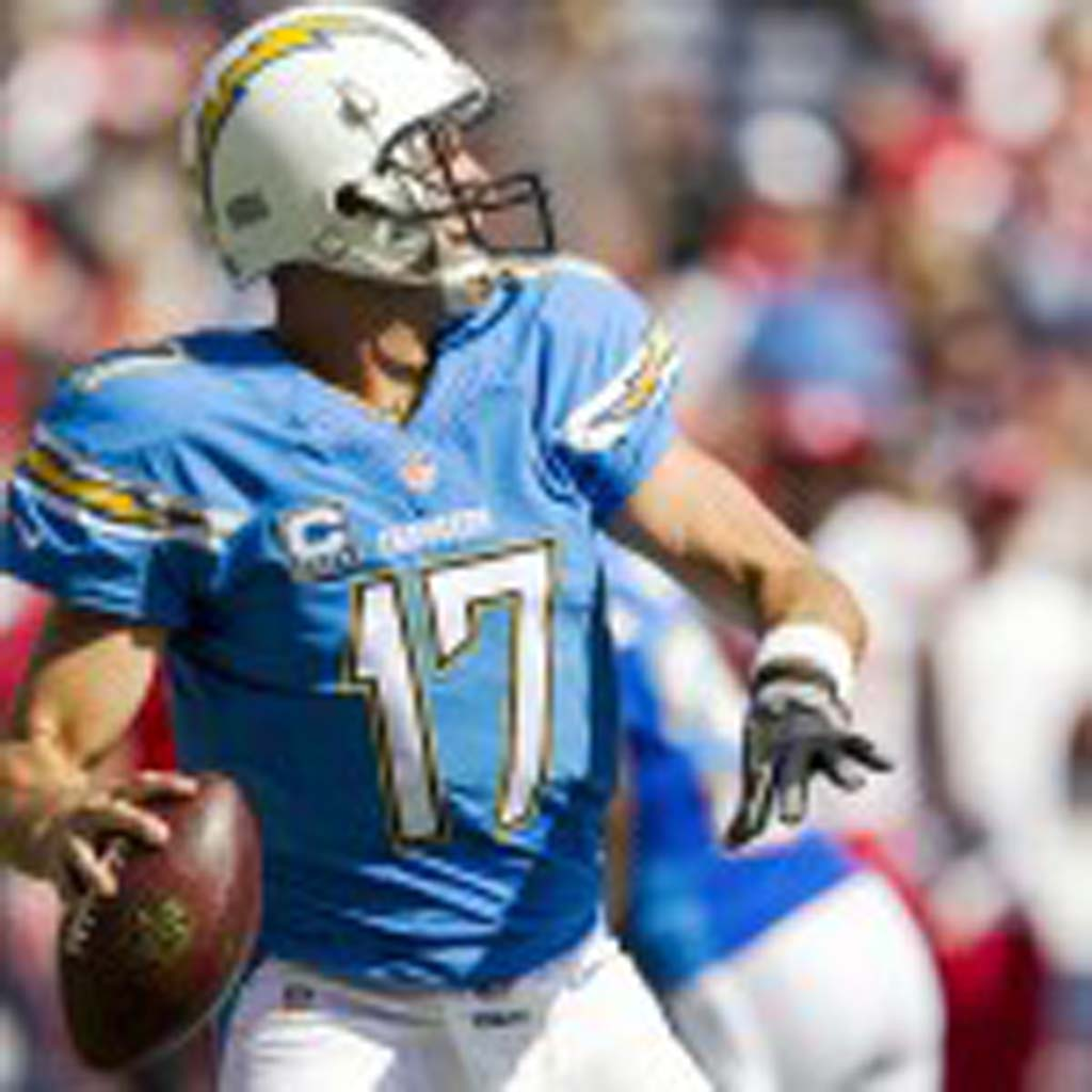San Diego quarterback Philip Rivers airs one out in the first quarter. Photo by Bill Reilly