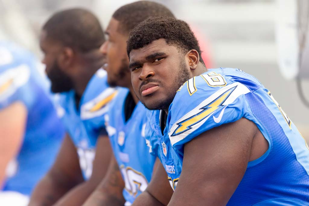 San Diego Charger tackle D.J. Fluker watches the game on the big screen. Photo by Bill Reilly