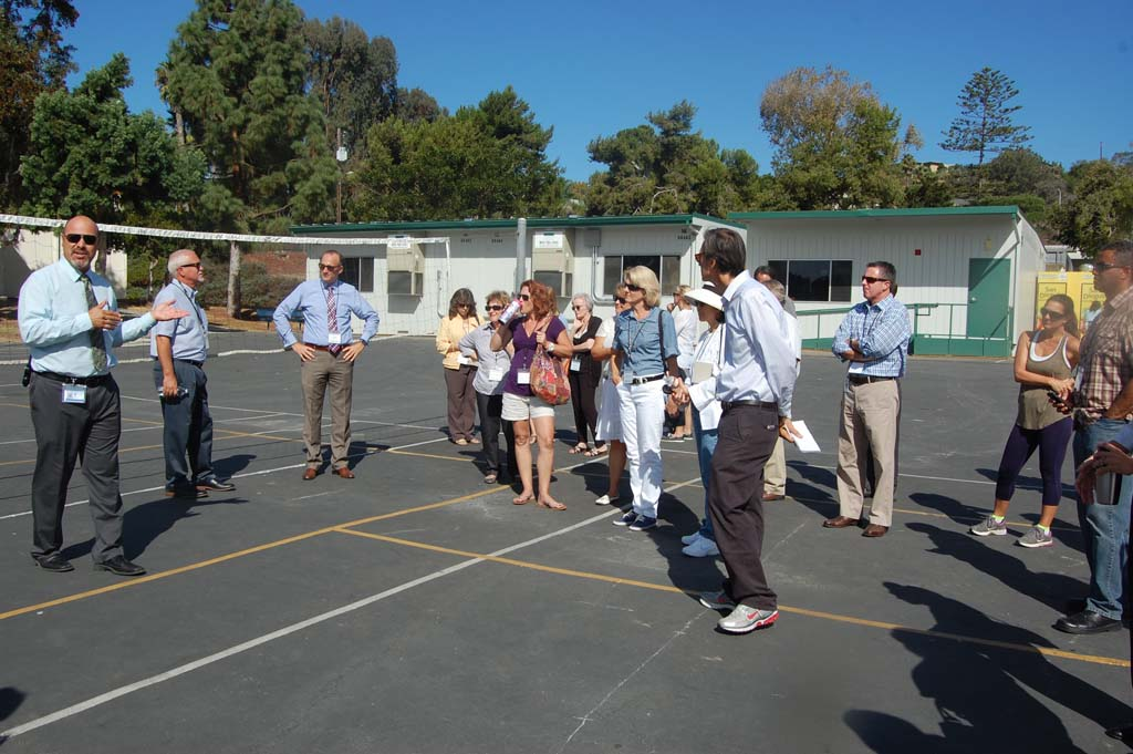 Adam Camacho, principal of Earl Warren Middle School, updates parent representatives, the board of trustees, members of an oversight committee and staff from San Dieguito Union High School District during a Proposition AA fall projects tour on Oct.6. Photo by Bianca Kaplanek