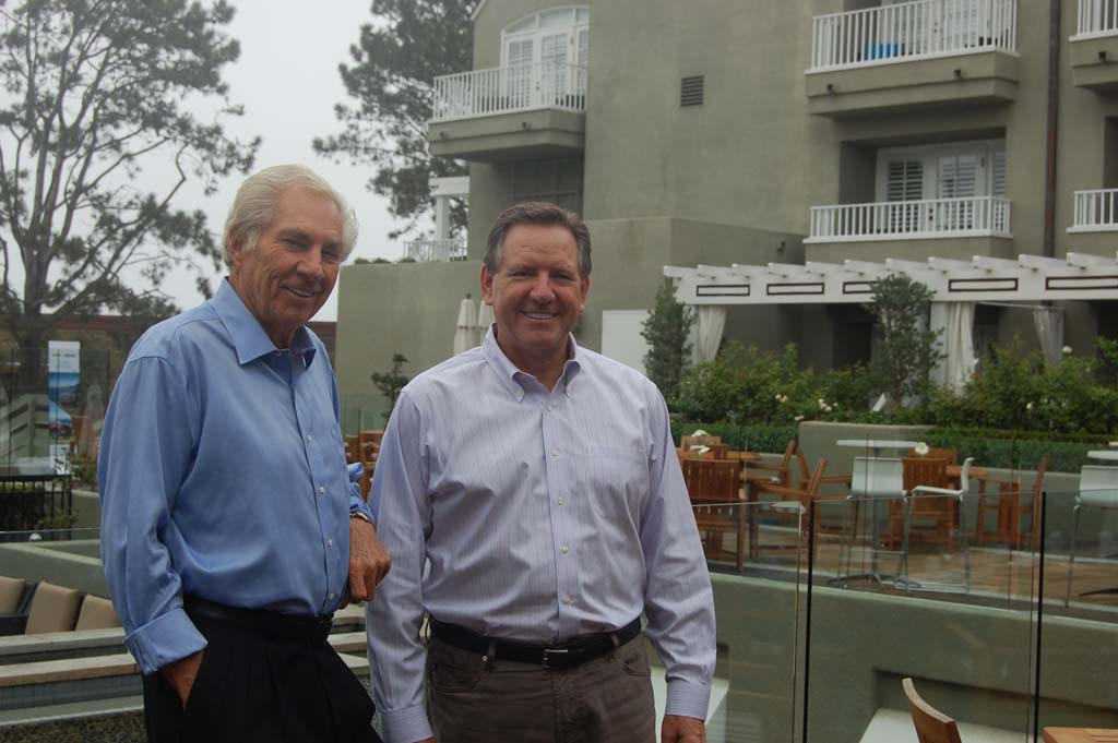 Standing in L'Auberge Del Mar's outside restaurant area are Jim Watkins, left, and General Manager Mike Slosser. When Watkins built the inn 25 years ago, there was no ocean view from the lobby, a change Slosser made during a 2007 renovation. Photo by Bianca Kaplanek