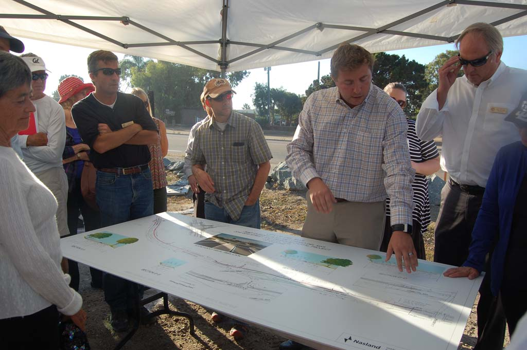 Residents listen at an Oct. 23 open house as Public Works Director Eric Minicilli explains the details of an improvement project that includes the installation of a roundabout at Jimmy Durante Boulevard and San Dieguito Drive. Photo by Bianca Kaplanek
